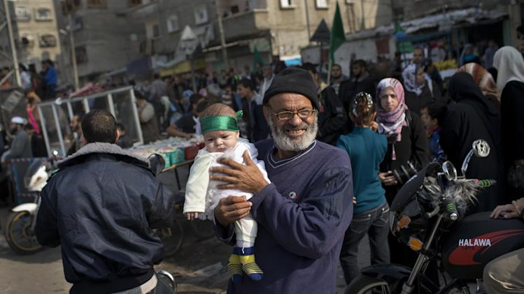 A Palestinian baby wears a Hamas bandana during a rally to celebrate the Israel-Hamas cease-fire in the Jebaliya refugee camp, north Gaza Strip, Thursday, Nov. 22, 2012. Gaza residents cleared rubble and claimed victory on Thursday, just hours after an Egyptian-brokered truce between Israel and Gaza's Hamas rulers ended the worst cross-border fighting in four years. (AP Photo/Bernat Armangue)