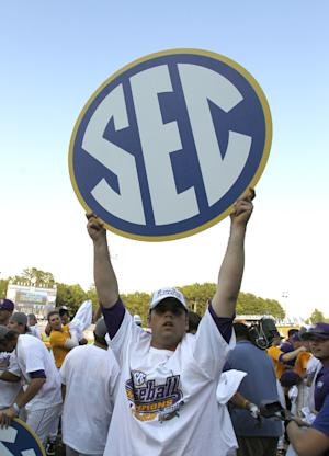 SEC hands out record $309.6M for 2013-14