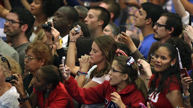 People wait for the arrival of President Barack Obama before he spoke at Florida Atlantic University, Tuesday, April 10, 2012, in Boca Raton, Fla. (AP Photo/Lynne Sladky)
