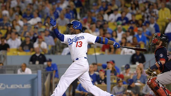 Los Angeles Dodgers' Hanley Ramirez, left, hits a two-run home run as Boston Red Sox catcher Jarrod Saltalamacchia looks on during the fourth inning of their baseball game, Friday, Aug. 23, 2013, in Los Angeles. (AP Photo/Mark J. Terrill)
