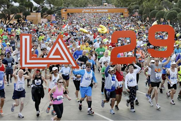 Runners in the Los Angeles Marathon take off from Dodger Stadium in Los Angeles, Sunday, March 9, 2014