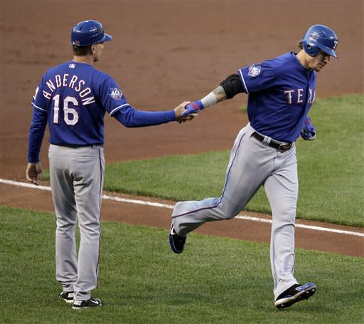 Rangers beat Orioles 7-3 for doubleheader split
