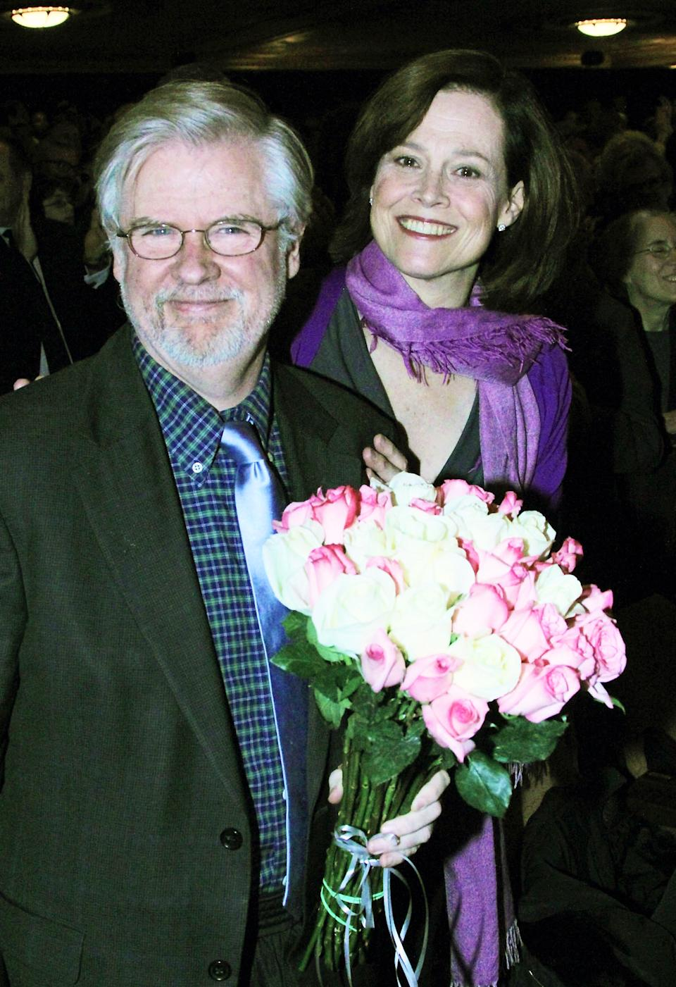 "This publicity image released by The O + M Company shows playwright Christopher Durang, left, with actress Sigourney Weaver at curtain call on opening night of ""Vanya and Sonia and Masha and Spike"". (AP Photo/The O + M Company, Bruce Glikas)"
