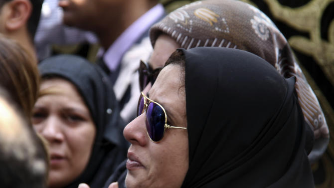 Mourners attend the burial of slain Egyptian Prosecutor General Hisham Barakat who was killed in bomb attack a day earlier, at a cemetery in Cairo, Egypt, Tuesday, June 30, 2015. Heavy security forces deployed across the Egyptian capital for the burial of Barakat, the top judicial official in charge of overseeing prosecution of thousands of Islamists. (AP Photo/Ahmed Gamil)