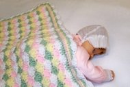 March is Crochet Month, so pick up that hook and learn how to crochet..  This pastel baby blanket is simple shells is a good beginner project.