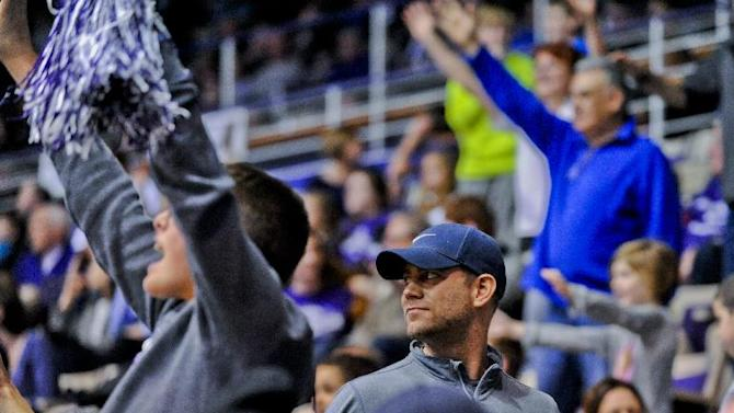 Chicago President of Baseball Operations Theo Epstein, center, walks on the sidelines during the second half of an NCAA college basketball game between Illinois-Chicago and Northwestern, Monday, Dec. 22, 2014, in Evanston, Ill. (AP Photo/Matt Marton)