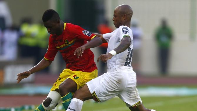 Andre Ayew of Ghana fights for the ball with Guinea's Abdoulaye Cisse during their quarter-final soccer match of the 2015 African Cup of Nations in Malabo