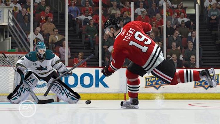 """This video game image released by EA Sports shows the San Jose Sharks battle the Chicago Blackhawks in a scene from """"NHL 13."""" (AP Photo/EA Sports)"""