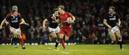 Wales' Liam Williams breaks through the Scottish defence during their Six Nations Championship rugby union match at the Millennium Stadium, Cardiff,