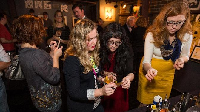 Guests participate in a cocktail-making contest during the Charleston Crown Royal Maple Finished launch party at Social Restaurant + Wine Bar Wednesday, January 30, 2013, in Charleston, S.C.  (Mic Smith / AP Images for Crown Royal)
