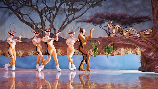 """This undated photo provided by Busch Gardens Tampa Bay & Adventure Island shows performers in a scene from """"Iceploration,"""" a new elaborate ice show at the theme park. The show is one of a number of new attractions at theme parks around the country this season. (AP Photo/Busch Gardens, Matt Marriott)"""