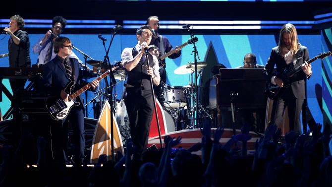 """FILE - In this Sun. Feb. 12, 2012 file photo, Adam Levine, center, and the band Maroon 5 perform during the 54th annual Grammy Awards in Los Angeles. Maroon 5's song """"Payphone (feat. Wiz Khalifa)"""" top downloaded single on iTunes for the week ending May 14, 2012. (AP Photo/Matt Sayles, File)"""