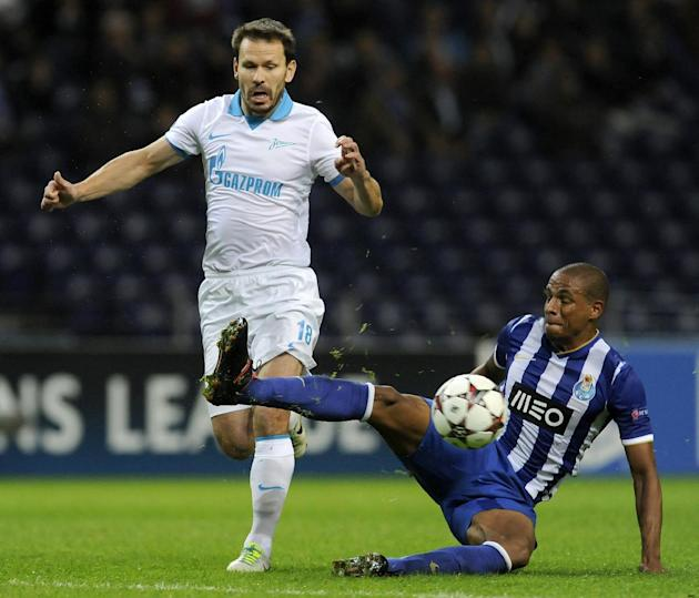 Porto's Fernando Reges, from Brazil, clears the ball from Zenit's Konstantin Zyryanov during the Champions League group G soccer match between FC Porto and Zenit Tuesday, Oct. 22, 2013, at the Dragao