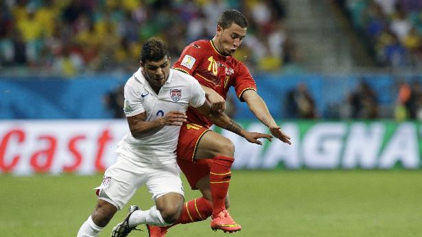 United States' DeAndre Yedlin, left, challenges Belgium's Eden Hazard during the World Cup round of 16 soccer match between Belgium and the USA at the Arena Fonte Nova in Salvador, Brazil, Tuesday, July 1, 2014