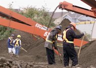 Archeologists work at Robert Pickton's pig farm, September 19, 2002. THE CANADIAN PRESS/AP, Richard Lam