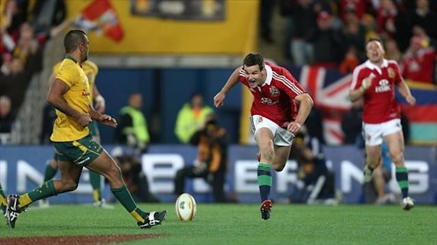 Jonathan Sexton, centre, scores a try during the third Test