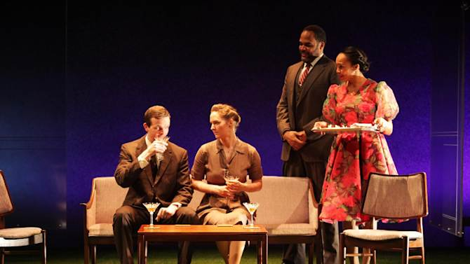 """Shown in a publicity photo released by Lincoln Center Theater are, from left, Dashiell Eaves, Amanda Quaid, Victor Williams and Eisa Davis in a scene from the LCT3 production of """"Luck of the Irish,"""" currently performing off-Broadway at the Claire Tow Theater in New York. (AP Photo/Lincoln Center Theater, Erin Baiano.)"""