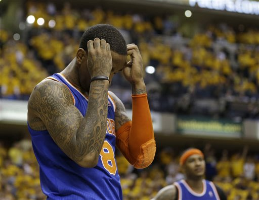 New York Knicks' J.R. Smith reacts late during the second half of Game 6 of an Eastern Conference semifinal NBA basketball playoff series against the Indiana Pacers, Saturday, May 18, 2013, in Indiana