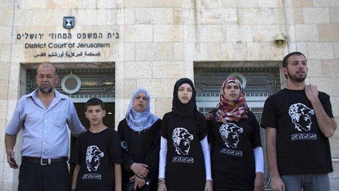 The family of 16-year old Mohammed Abu Khder, who was kidnapped from east Jerusalem on July 2 and burned to death, stand outside the District Court in Jerusalem, on August 6, 2014
