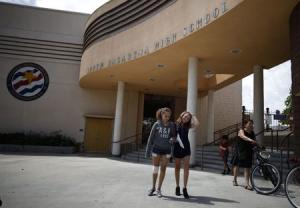 People walk out of South Pasadena High School in South Pasadena