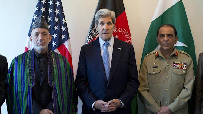 U.S. Secretary of State John Kerry, center, makes a statement before meeting with Afghan President Hamid Karzai, left, and Pakistani Army Chief Gen. Asfhaq Parvez Kayani on Wednesday, April 24, 2013, in Brussels, Belgium. The trilateral meeting is to discuss regional security issues, and the 2014 withdrawal of NATO combat forces from Afghanistan. (AP Photo/Evan Vucci, Pool)