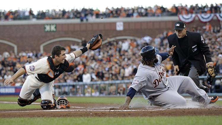 Detroit Tigers' Prince Fielder is tagged out at home plate by San Francisco Giants' Buster Posey, left, during the second inning of Game 2 of baseball's World Series Thursday, Oct. 25, 2012, in San Francisco. Umpire Dan Iassogna makes the call at the plate. (AP Photo/Marcio Jose Sanchez)