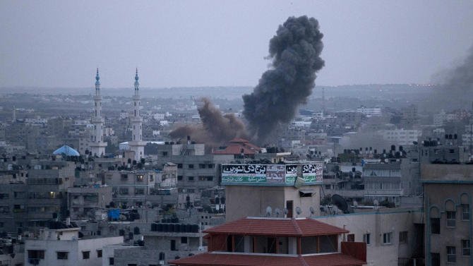 Smoke rises following an Israeli attack in Gaza City, Friday, Nov. 16, 2012. (AP Photo/Majed Hamdan)