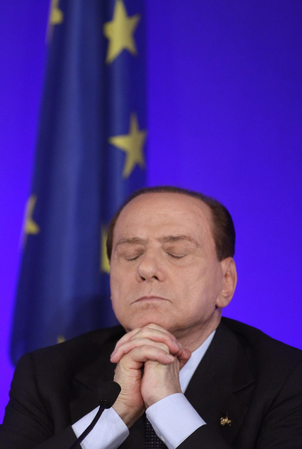 Italian Prime Minister Silvio Berlusconi pauses before speaking during a media conference at a G20 summit in Cannes, France on Friday, Nov. 4, 2011. Leaders from within troubled Europe and far beyond are working Friday on ways the International Monetary Fund could do more to calm Europe's debt crisis. (AP Photo/Michel Euler)
