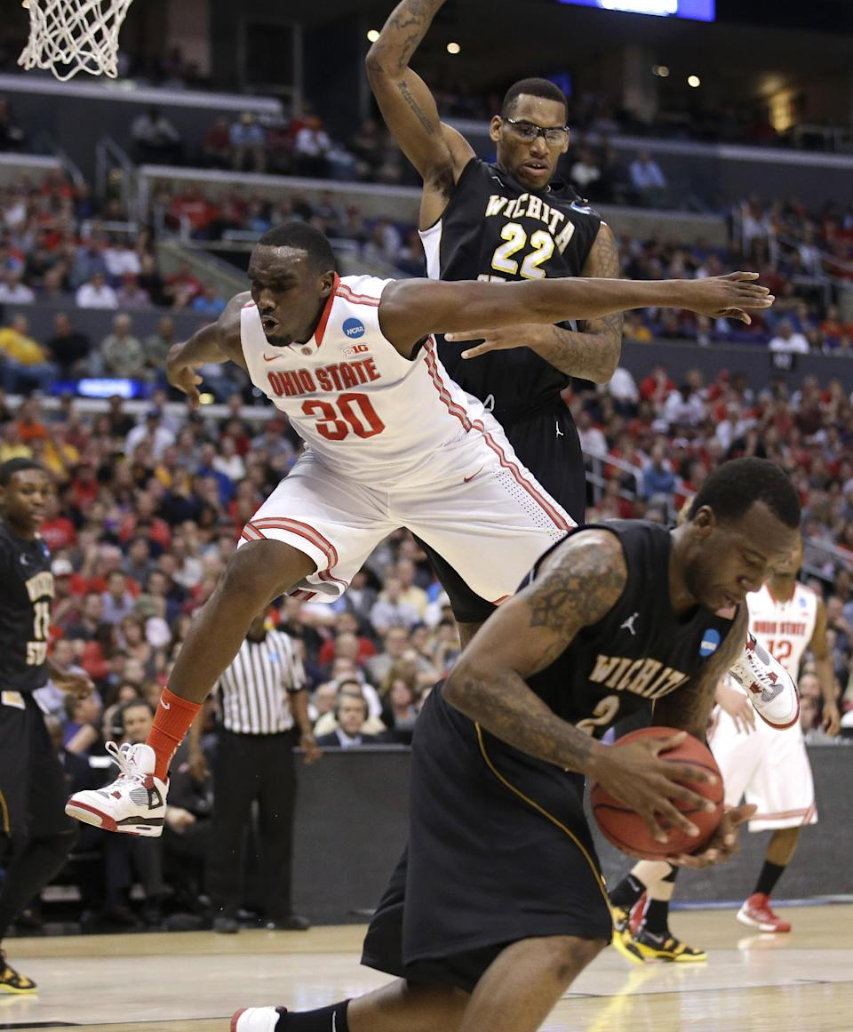 Wichita State's Carl Hall, rear, and Malcolm Armstead, right, break up a scoring attempt by Ohio State forward Evan Ravenel (30) during the first half of the West Regional final in the NCAA mens' college basketball tournament, Saturday, March 30, 2013, in Los Angeles. (AP Photo/Jae C. Hong)