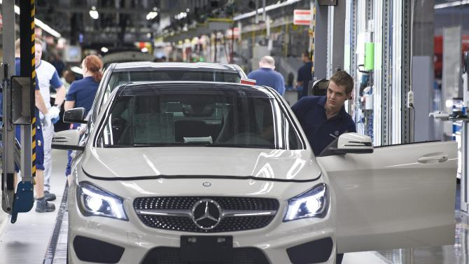 FILE - In this Wednesday, May 8, 2013 file photo a CLA car is assembled in the car manufacturing plant of Mercedes-Benz Manufacturing Hungary Kft., an affiliate of Daimler AG of German carmaker Mercedes-Benz in Kecskemet, 85 kms southeast of Budapest, Hungary. Automaker Daimler AG laid out the hope of a recovery in the West European car market later this year as it reported a big jump in its second-quarter net profit following the sale of its stake in aerospace firm EADS. The Stuttgart-based company said Wednesday July 24, 2013 that net profit rose to €4.58 billion ($6.04 billion) from €1.56 billion in the same quarter a year before. Sales rose 3 percent to €29.7 billion. (AP Photo/MTI, Sandor Ujvari, File)