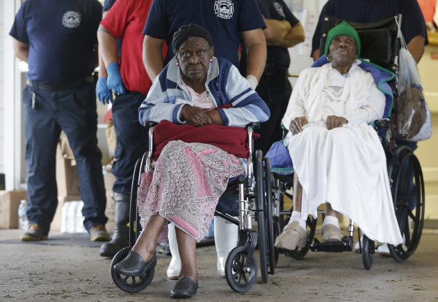 Residents of the Riverbend Nursing Center wait to be evacuated to higher and safer ground as Hurricane Isaac makes landfall, Wednesday, Aug. 29, 2012, in Jesuit Bend, La. Plaquemines Parish ordered a