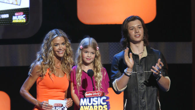 Denise Richards, Lola Sheen and Leo Howard onstage during the Radio Disney Music Awards at the Nokia Theatre on Saturday, April 27, 2013 in Los Angeles. (Photo by Todd Williamson /Invision/AP)