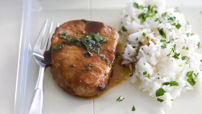 In this image taken on Jan. 21, 2013, a sticky marinated pork chop is shown in Concord, N.H. (AP Photo/Matthew Mead)