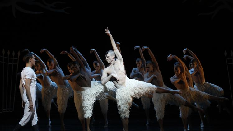 Dancer Sam Archer performs as the Prince and Jonathan Ollivier performs as the swan with male swans in London