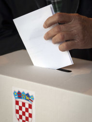 A voter casts his ballot at a polling station in Zagreb, Croatia, Sunday, Jan. 22, 2012. Croatians vote Sunday in a nationwide referendum on whether to join the European Union, a test of how much the debt-stricken 27-nation bloc has lost its appeal among potential new members. (AP Photo/Darko Bandic)