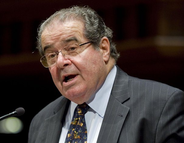 "FILE - In this March 8, 2012 file phoo, Supreme Court Justice Antonin Scalia speaks at Wesleyan University in Middletown, Conn. Scalia says his method of interpreting the Constitution makes some of the most hotly disputed issues that come before the Supreme Court among the easiest to resolve. Scalia calls himself a ""textualist"" and, as he related to a few hundred people who came to buy his new book and hear him speak in Washington the other day, that means he applies the words in the Constitution as they were understood by the people who wrote and adopted them. (AP Photo/Jessica Hill, File)"