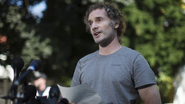 Curtis, an American writer released this week after nearly two years of captivity in Syria, talks to reporters near his mother's home in Cambridge