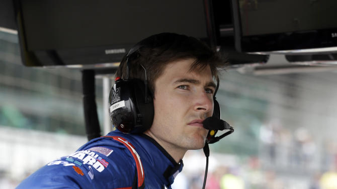 JR Hildebrand watches the race from the pit area during the Indianapolis 500 auto race at Indianapolis Motor Speedway in Indianapolis, Sunday, May 26, 2013. Hildebrand crashed early in the race. (AP Photo/Darron Cummings)