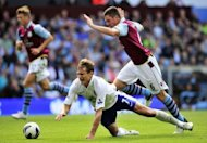 Everton's striker Nikica Jelavic (L) is fouled by Aston Villa's defender Ciaran Clark (R) resulting in a red card for Clark during their English Premier League football match at Villa Park in Birmingham. Everton won 3-1