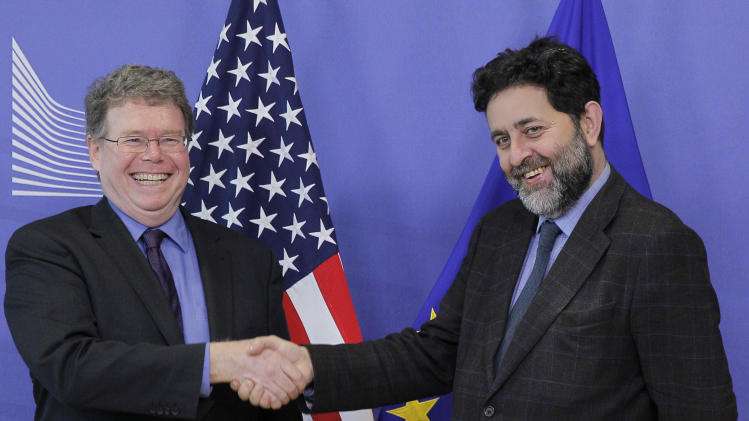 EU chief negotiator Ignacio Garcia Bercero, right, shakes hands with U.S. Assistant Trade Representative for Europe and the Middle East Daniel Mullaney, upon arrival at the European Commission headquarters in Brussels, Monday, Nov. 11, 2013. U.S. and European negotiating teams resumed talks Monday on what could become the biggest trade agreement in history: the Transatlantic Trade and Investment Partnership. (AP Photo/Yves Logghe)