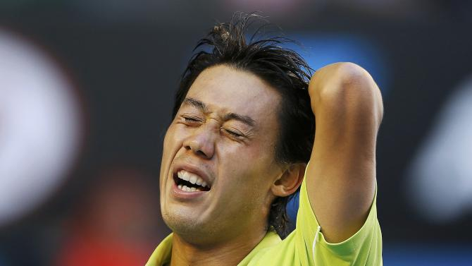 Nishikori of Japan reacts after defeating Ferrer of Spain in their men's singles fourth round match at the Australian Open 2015 tennis tournament in Melbourne