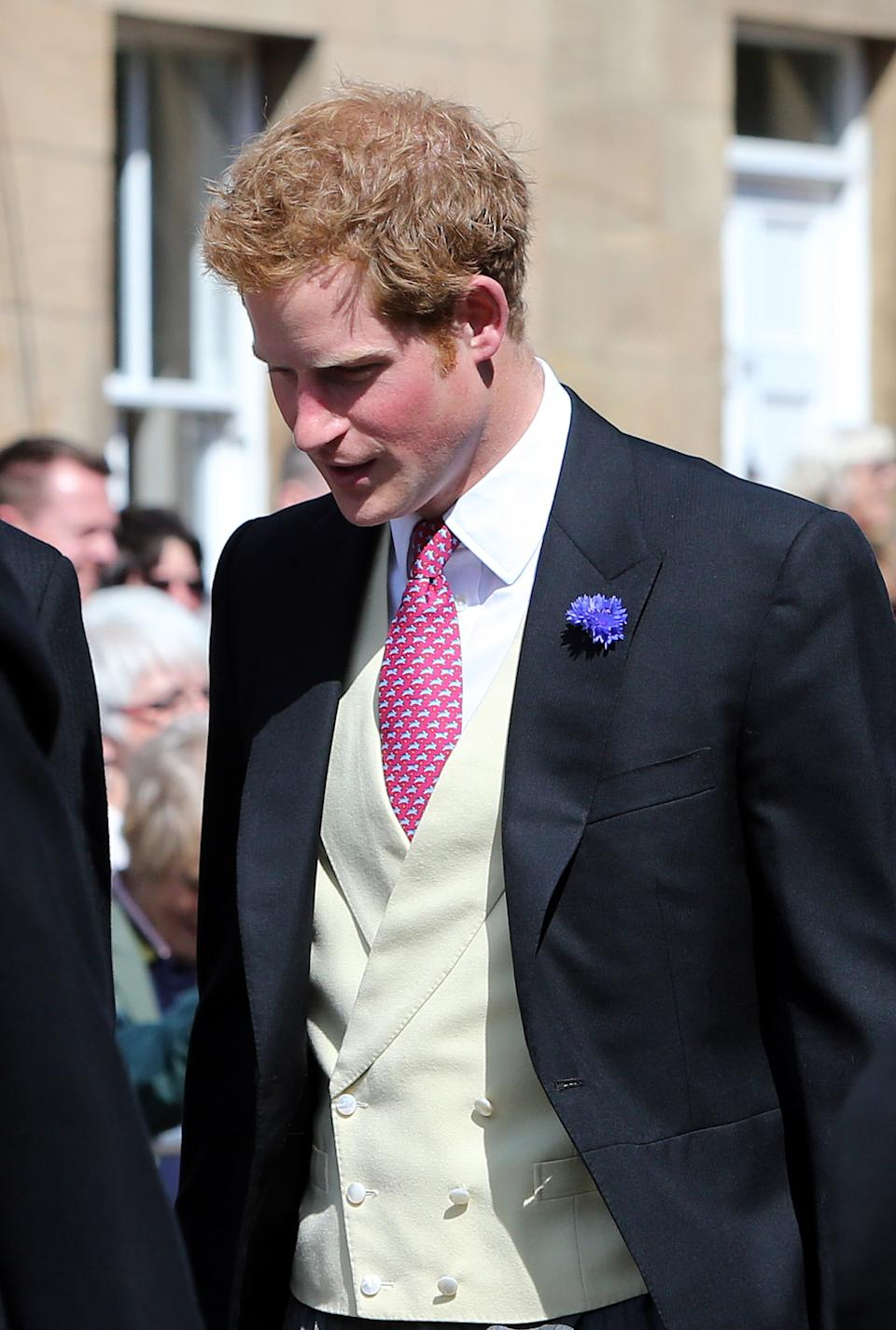 Britain's Prince Harry arrives at the wedding of the Duke and Duchess of Northumberland's daughter Lady Melissa Percy to chartered surveyor Thomas van Straubenzee at St Michael's Church in Alnwick, England, Saturday, June 22, 2013. (AP Photo/Scott Heppell)