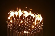 The Olympic flame is seen in the stadium during the opening ceremony of the London 2012 Olympic Games, on July 27