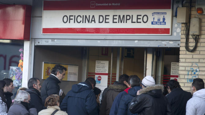 People queue to enter an unemployment registry office in Madrid, Thursday Jan. 24, 2013. Spain's unemployment rate shot up to a record 26.02 percent in the fourth quarter of 2012 leaving almost million people now out of work, the National Statistics Institute said Thursday. Over the year, 691,700 more people lost their jobs, the institute said, adding that there were now a rounded 1.8 million households in which no one was employed. Spain is in the throes of its second recession in just over three years following the collapse of its once-booming real estate sector in 2008. (AP Photo/Paul White)