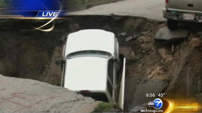 Giant sinkhole swallows 3 cars on South Side