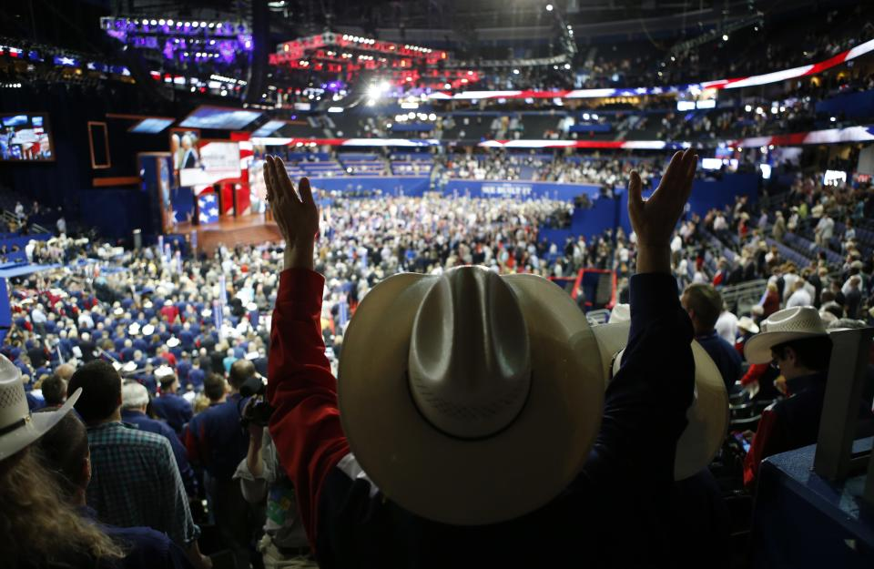 Texas alternate delegate Linda Patterson from Grand Prairie, Texas raises her arms up in the air to pray at the Republican National Convention in Tampa, Fla., on Tuesday, Aug. 28, 2012. (AP Photo/Jae C. Hong)