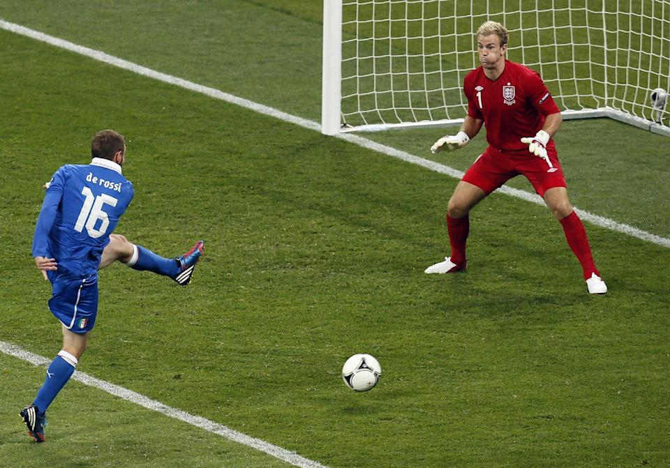 Italy's Daniele De Rossi misses a chance to score in front of England goalkeeper Joe Hart during the Euro 2012 soccer championship quarterfinal match between England and Italy in Kiev, Ukraine, Sunday, June 24, 2012. (AP Photo/Vadim Ghirda)