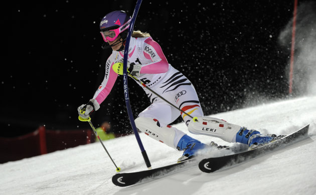 Germany's Maria Hoefl-Riesch speeds past a pole on her way to clock the fastest time in the first run of an alpine ski, women's World Cup slalom, in Flachau, Austria, Tuesday, Jan. 15, 2013. (AP Photo/Giovanni Auletta)