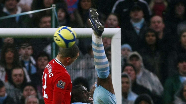 Manchester City's Micah Richards, right, vies for the ball against Manchester United's Chris Smalling during their English FA Cup third round soccer match at Etihad Stadium, Manchester, England, Sunday Jan. 8, 2012. (AP Photo/Tim Hales)