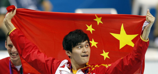 China's Sun Yang reacts on the podium after winning in the gold medal in the men's 1500-meter freestyle swimming final at the Aquatics Centre in the Olympic Park during the 2012 Summer Olympics, London, Saturday, Aug. 4, 2012. (AP Photo/Jae C. Hong)